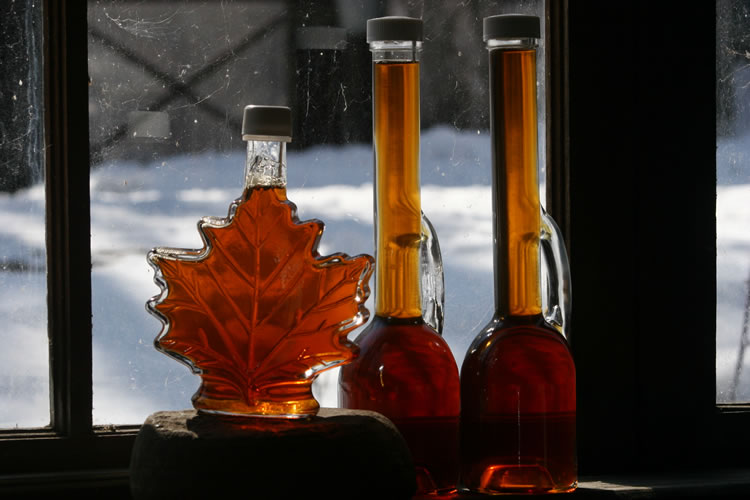 Maple Syrup bottles on window ledge
